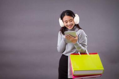 happy asian woman shopping online