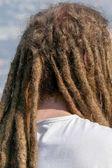 Fotografie Dreadlocks Frisur des Mannes. Haare Dreadlocks Reggae Stil