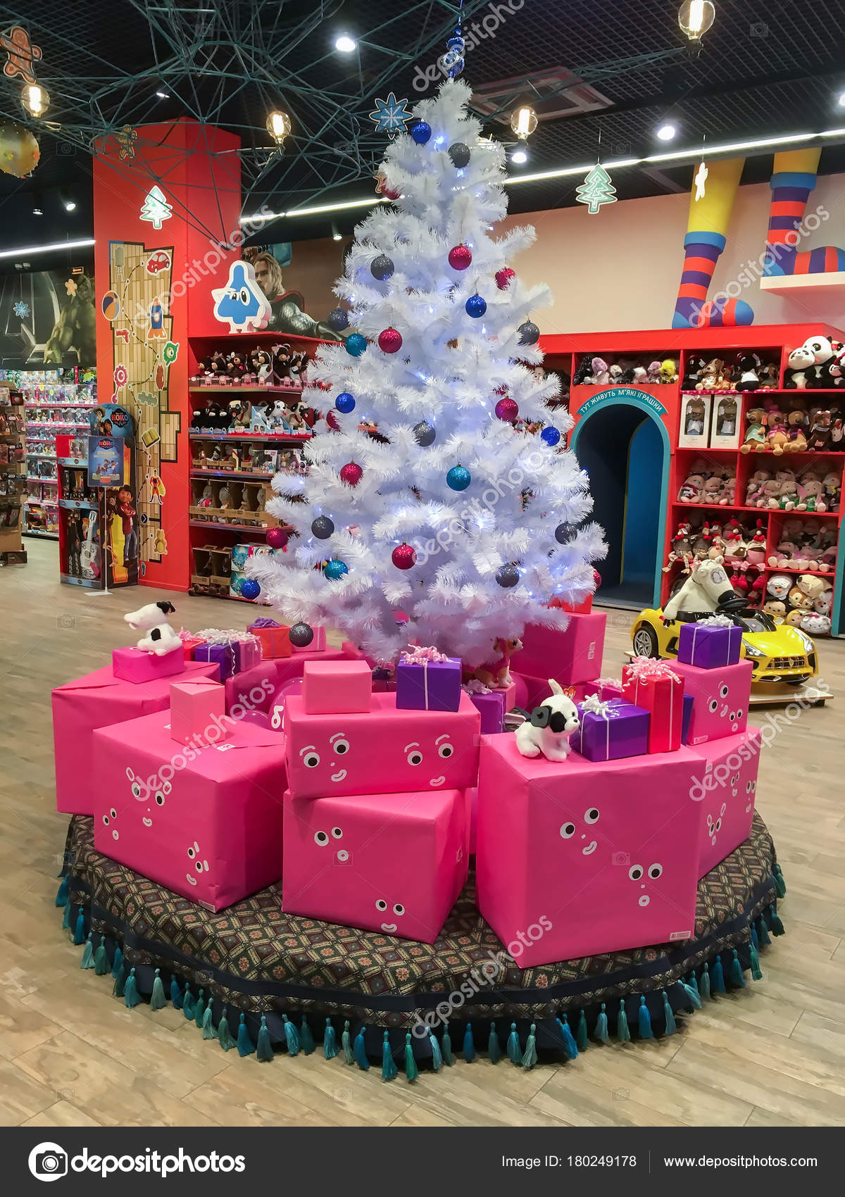 White Christmas tree and gifts under it in the children\'s store ...