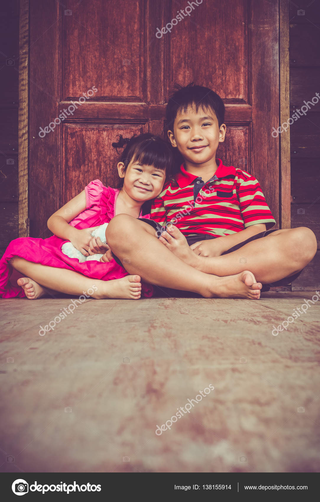 Asian brother with his sister smiling happy together. Vintage tone– stock  image
