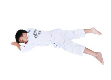 Accidents in sports. Asian child athletes taekwondo lying prone position unconscious