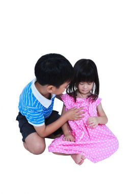 Elder brother hugging and soothing a crying his sister. Isolated on white background.