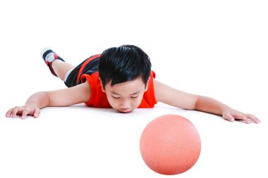 Accidents in sports. Child in prone position unconscious with ball. Isolated on white background..