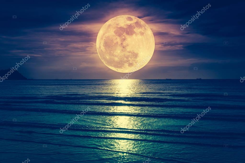 Super moon. Colorful sky with cloud and bright full moon over sea. Serenity nature background.