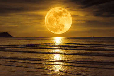 Super moon. Colorful sky with cloud and bright full moon over sea