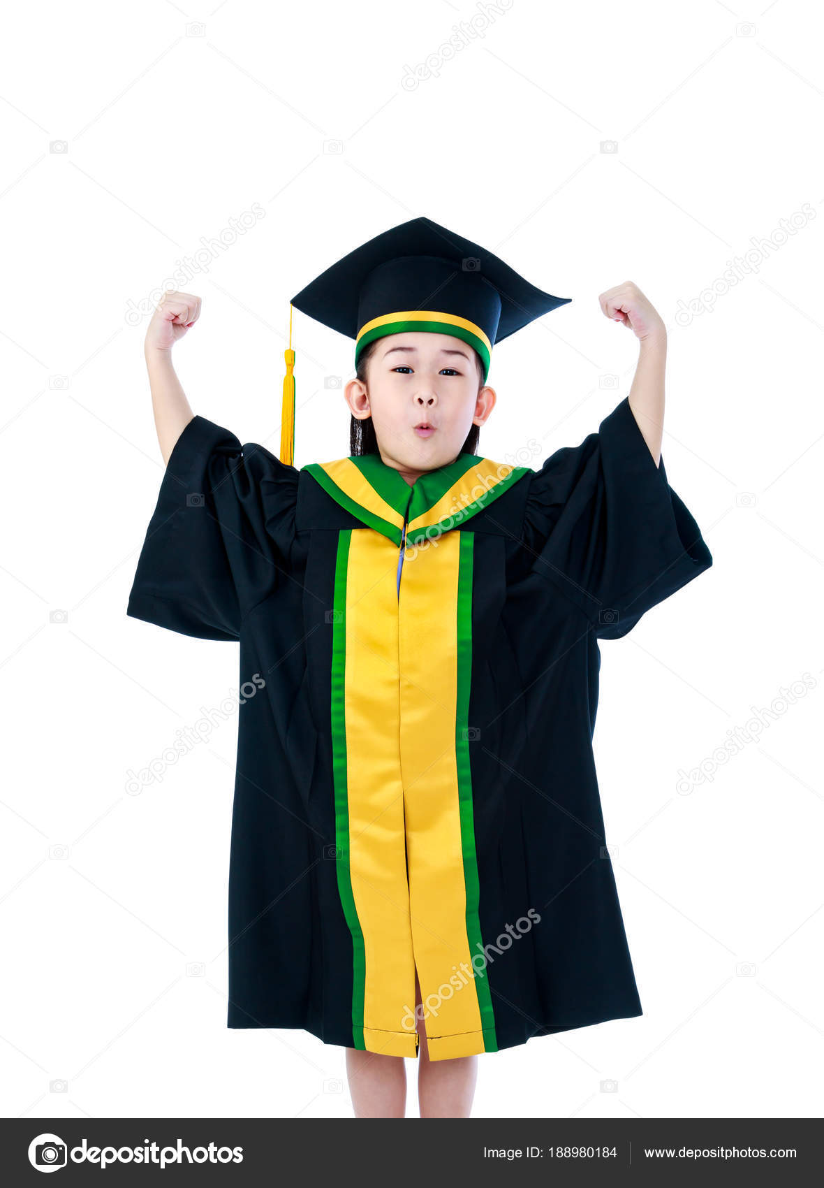 Asian child in graduation gown with her hands up. Isolated on wh ...