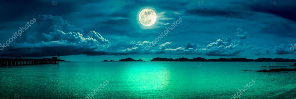 Фотообои Panorama of sky with full moon on seascape to night.