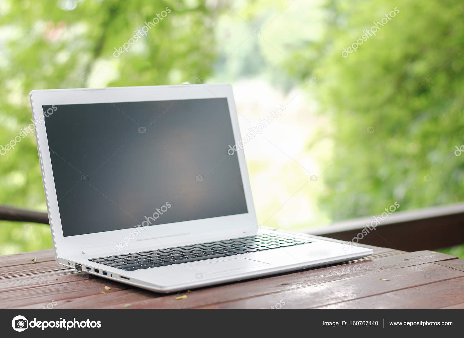 Computer Laptop With Blank Back Screen On Wooden Table With Green Garden  Nature Background U2014 Photo By Singkamc