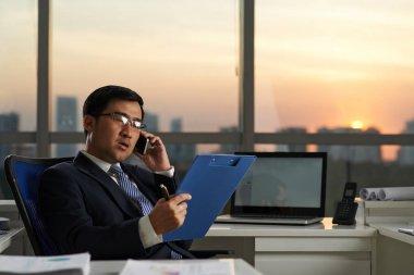 entrepreneur reading document
