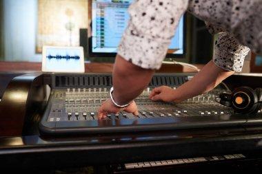 musician working on music mixer