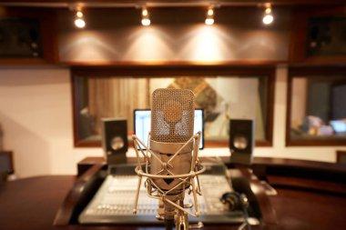 Microphone in empty music studio