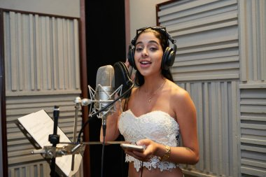 woman recording song