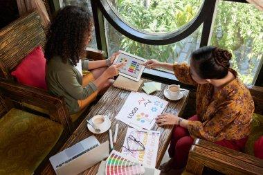 Business ladies discussing color scheme