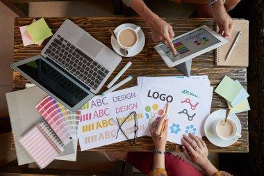 businesswomen discussing design of website