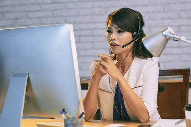 businesswoman in headset consulting client
