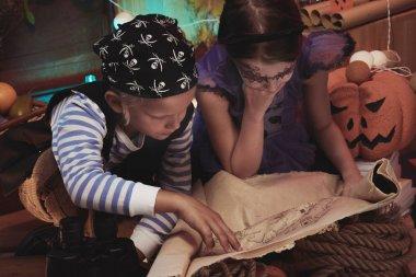 Children examining pirate map