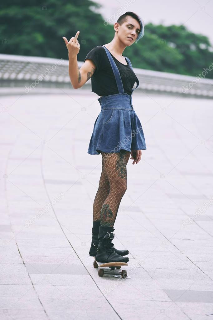Girl on skateboard showing middle finger stock photo girl on skateboard showing middle finger stock photo voltagebd Gallery