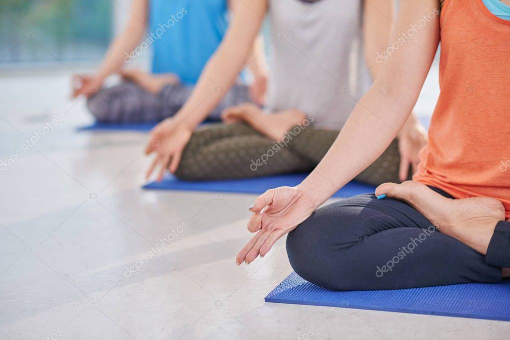 women practicing lotus position