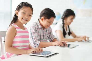 students using tablet computer in class