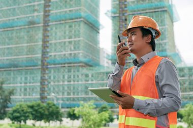 contractor using walkie-talkie