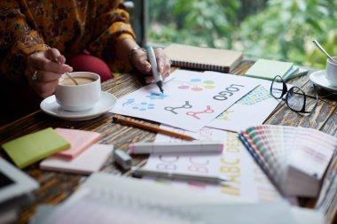Female designer working on logo