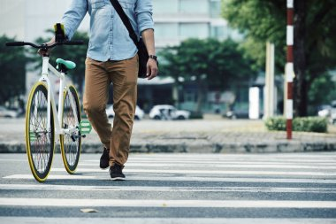 Man crossing road with bike