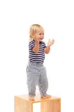 Cheerful boy dancing