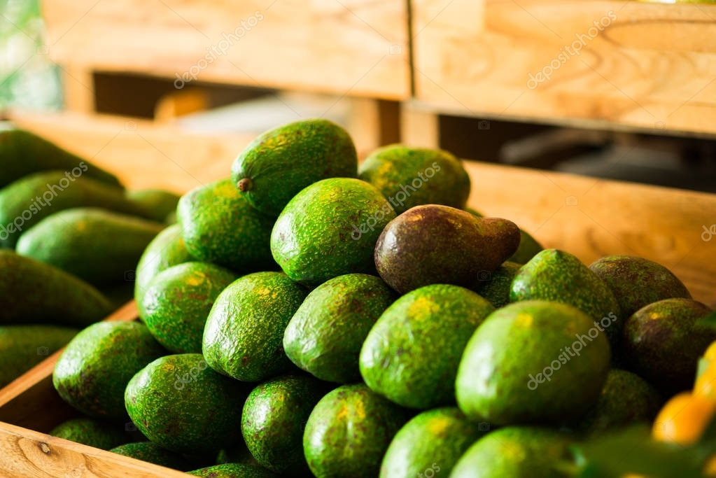 Pile of fresh ripe avocados