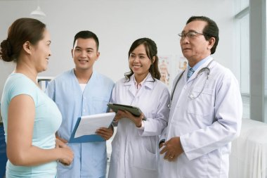 woman with team of doctors