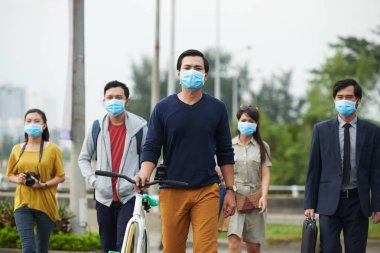 Passers-by protected themselves from swine flu with help of masks while walking in Asian city stock vector