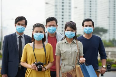 Asian people looking at camera with dissatisfied face expressions while suffering from air pollution in city center stock vector