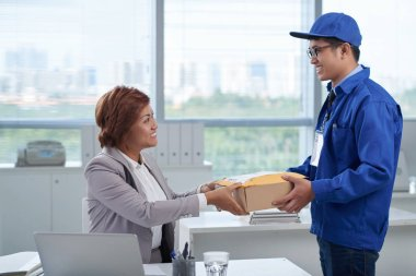 Business woman receiving package