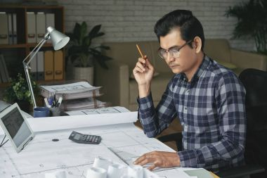 Vietnamese professional engineer working on housing project