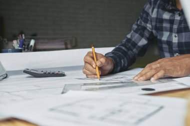 Closeup image of architect sketching construction project