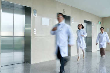 Doctors walking in hall on hospital building, blurred motion stock vector