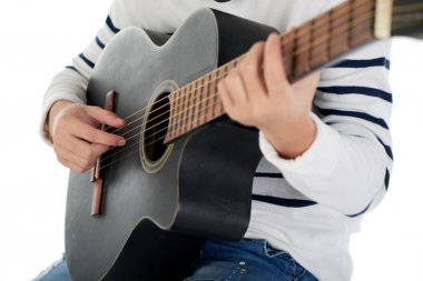Cropped image of musician playing guitar, selective focus