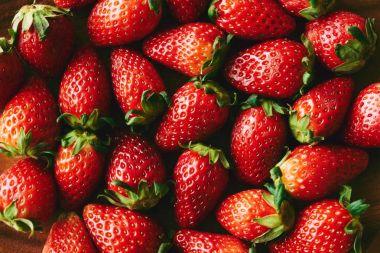 Background of many fresh ripe organic strawberries