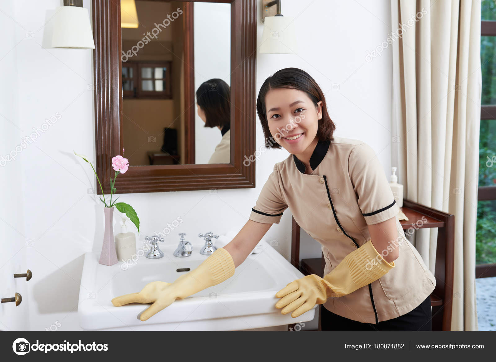 Asian Hotel Maid Cleaning Sink Suite Bathroom Stock Photo - Bathroom maid