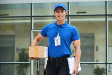 Portrait of smiling courier with a package