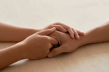 CLose-up image of hands of woman reassuring her boyfriend