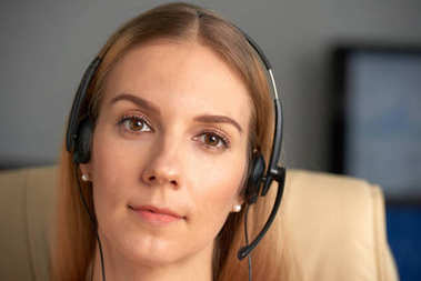 Face of technical support manager in headset