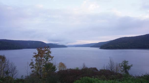 Early morning over the Allegheny reservoir in autumn. The low clouds move rapidly over the water, and the day breaks.