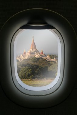 The window of airplane with travel destination attraction. Myanm