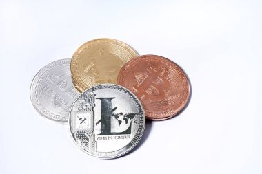 LTC Litecoin silver coin and Bitcoin on white background with co