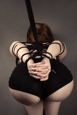 sexy ass female slave with tied hands closeup
