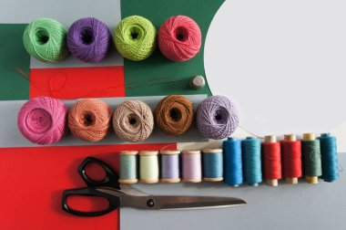 yarns of threads for knitting in different colors on a palette background