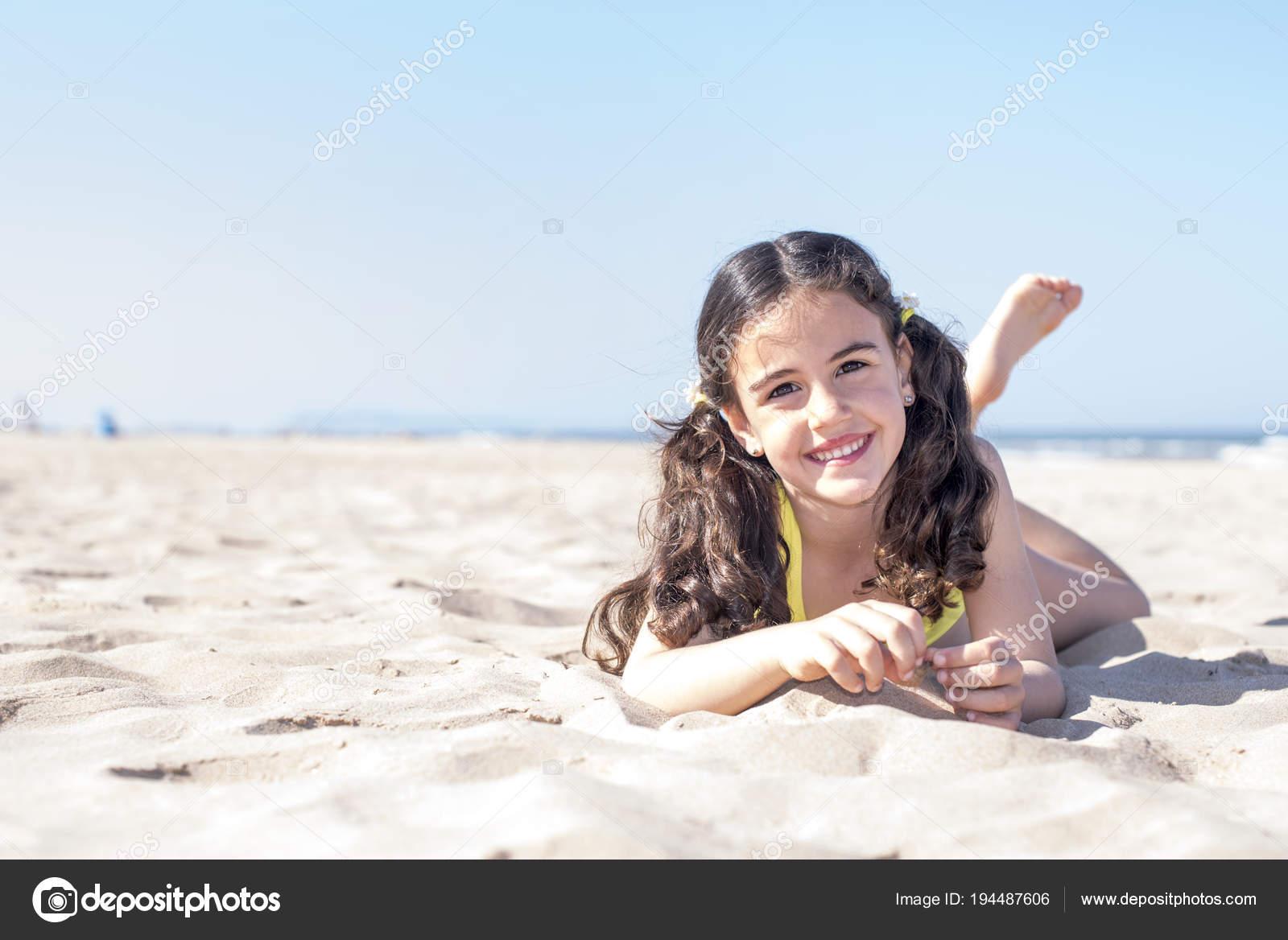 little girl pose beach Little girl posing at the seaside