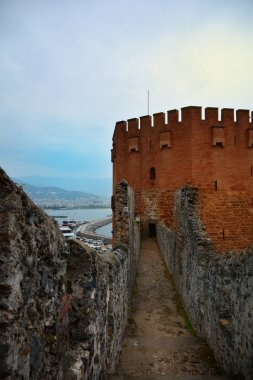 View of Red Tower (Kizil Kule) and ancient stone wall of Alanya