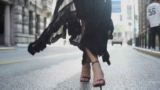 Attractive young woman in wonderful dress are walking on the street