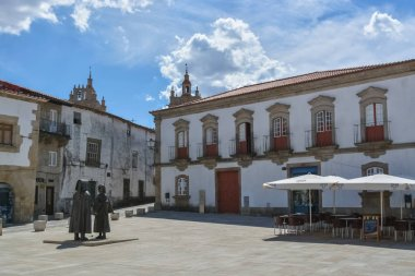 View of a plaza with a statue of a typical man and woman from Miranda, on interior fortress on medieval city of Miranda do Douro